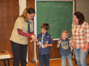 His den leader, Sis. Yancey, awarding his Bear and Whittling Chip.